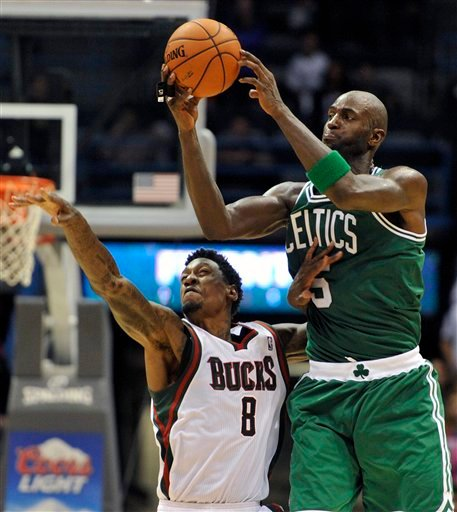 Milwaukee Bucks' Larry Sanders (8) tries to steal the ball from Boston Celtics' Kevin Garnett (5) during the second half of an NBA basketball game, Saturday, Nov. 10, 2012, in Milwaukee. The Celtics defeated the Bucks 96-92. (AP Photo/Jim Prisching)