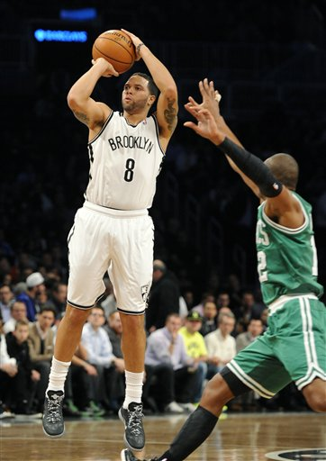 Brooklyn Nets' Deron Williams (8) shoots around Boston Celtics' Leandro Barbosa (12) in the first half of a basketball game on Thursday, Nov., 15, 2012, at Barclays Center in New York. The Nets won 102-97. (AP Photo/Kathy Kmonicek)