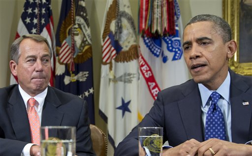 "President Barack Obama, right, accompanied by House Speaker John Boehner, R-Ohio, speaks to reporters in the Roosevelt Room of the White House in Washington. The two leaders are trying to forge a compromise to avoid the ""fiscal cliff"" -- a combination of factors that threaten to invoke automatic tax increases and spending cuts on Jan. 1, which many claim would be ruinous to the nation's fragile economy."