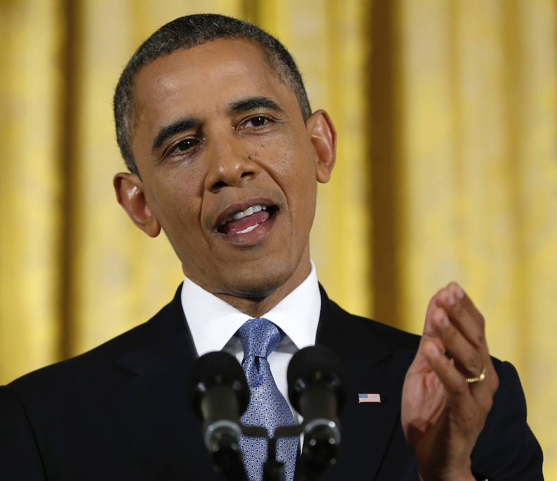This Nov. 14, 2012 file photo shows President Barack Obama gesturing while answering a question during a news conference in the East Room of the White House in Washington. It's entirely possible that lawmakers and the White House will reach a deal to avert an avalanche of tax increases and deep cuts in government programs before a Jan. 1 deadline. To do so, however, they'll have to resolve serious political and fiscal dilemmas that have stymied them time after time, despite repeated vows to overcome them. (AP Photo/Carolyn Kaster, File)