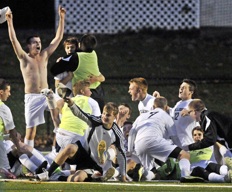 REASON TO SHOUT: Hall-Dale High School celebrates after beating Waynflete in the Western Maine Class C boys soccer championship game Thurday at Thomas College in Waterville. The Bulldogs won 1-0, beating the Flyers in a penalty kick shootout.