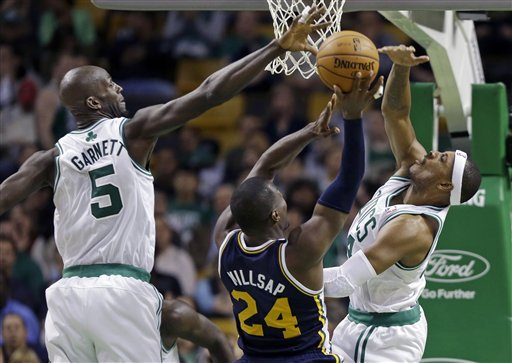 Utah Jazz forward Paul Millsap (24) tries to shoot against the defense of Boston Celtics forwards Kevin Garnett (5) and Paul Pierce, right, in the second half of an NBA basketball game in Boston, Wednesday, Nov. 14, 2012. The Celtics won 98-93. (AP Photo/Elise Amendola) TD Garden