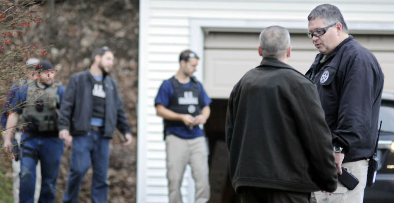 U.S. Marshals Service investigators search the residence of Barbara Cameron, the ex-wife of fugitive James Cameron, Tuesday afternoon in Hallowell. Authorities on Tuesday continued to hunt for Cameron, Maine's former top drug prosecutor, who cut off his electronic monitoring bracelet and fled on Thuesday, after learning his appeal of child pornography convictions had partially failed.