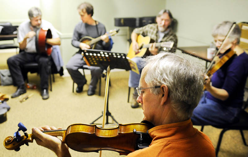 Acoustic musicians jam Sunday at the Viles Arboretum in Augusta during the inaugural get-together for either aspiring or experienced musicians. The group plans to meet monthly at the arboretum with an hour of slow jam for novice players, and a couple hours to follow of bluegrass and contra tunes.