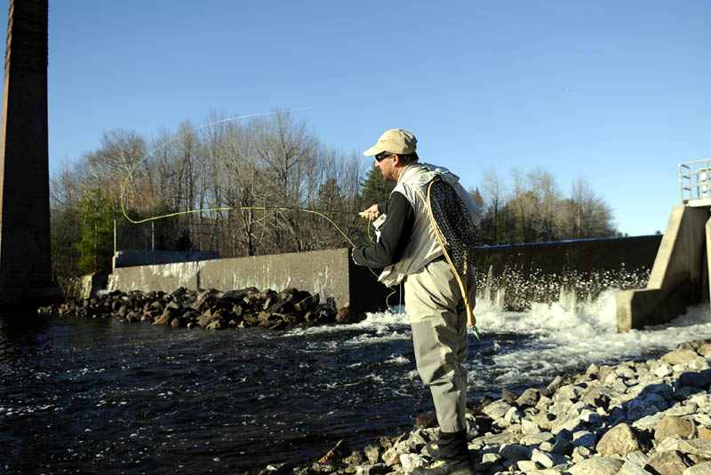Chris Rollins casts a streamer Wednesday at the dam on Echo Lake in Mount Vernon. The angler, who cast flies across the western United States this summer, was searching for spawning trout and salmon in tail waters across Kennebec County.