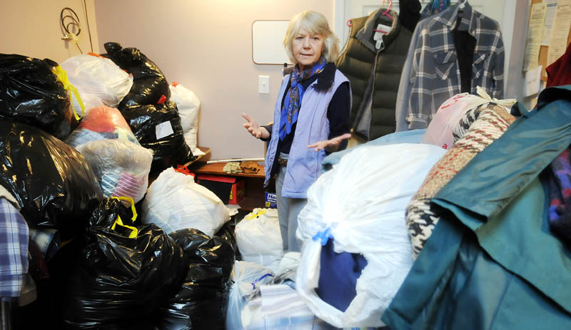 Sandy Phillips is storing clothing donated to the Winthrop United Methodist Church at her Winthrop business that will be contributed to victims of Superstorm Sandy.