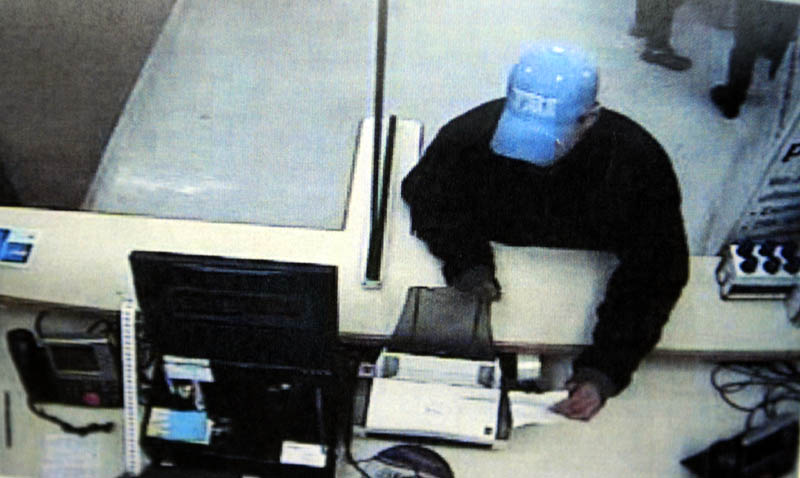 A security camera photo of a man who robbed the pharmacy of the Walmart in Augusta on Monday. He was was described as a young, white man about 5 feet 7 inches tall and wearing a blue coat and a blue baseball cap.