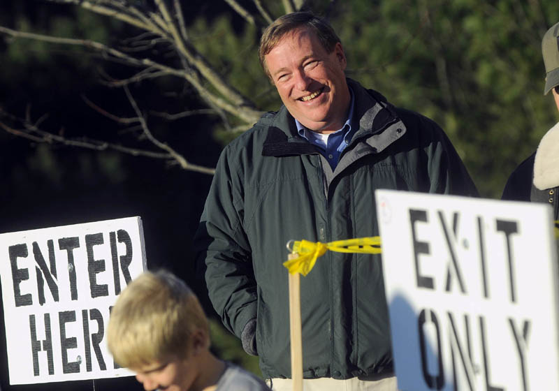 Kevin Raye greets voters at the polls at the Hampden Municipal Building on Tuesday.