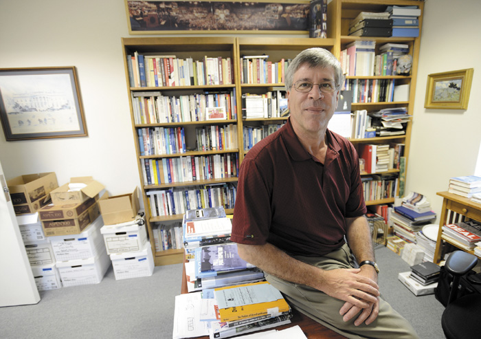 Anthony Corrado, a well-known expert on the subject of campaign finance, in his office at Colby College in Waterville on July 24.