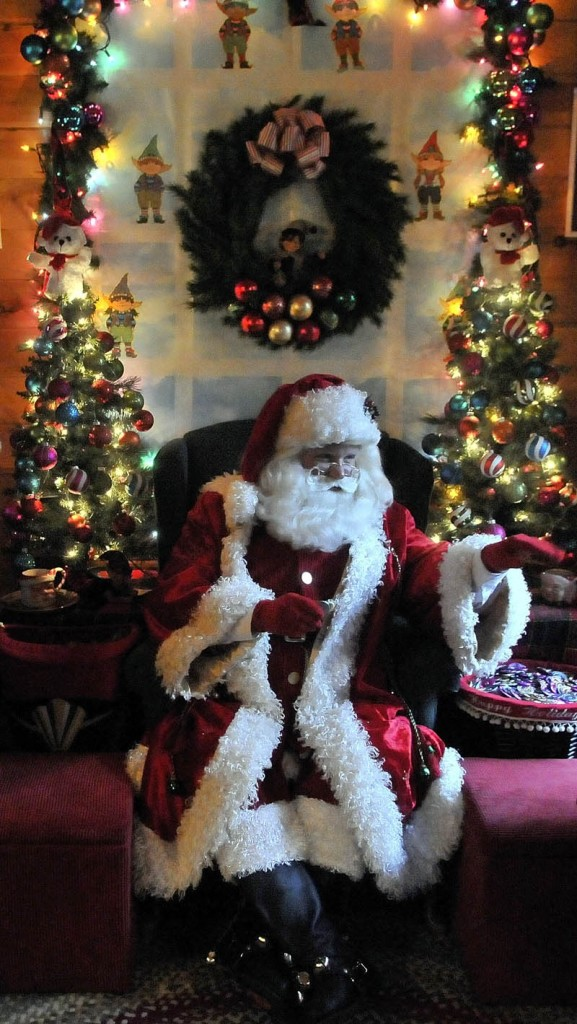 """Santa Claus says """"goodbye"""" to some children, at Kringleville in Castonguay Square in downtown Waterville, on Saturday."""