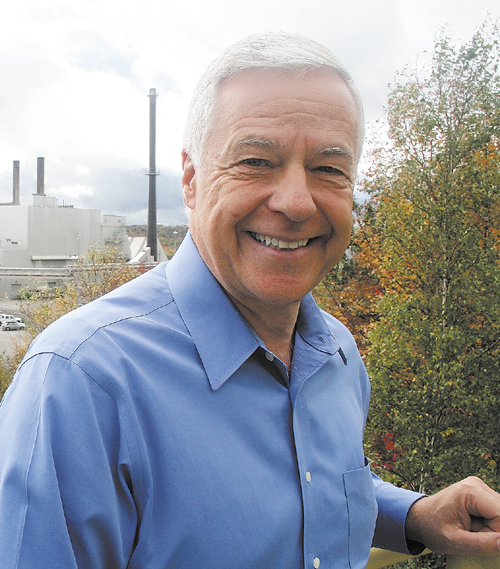 U.S. Representative Mike Michaud stands outside Great Northern Paper mill in East Millinocket.