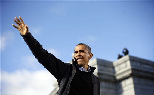 President Barack Obama waves to supporters during a campaign event at Capitol Square on Sunday in Concord, N.H.