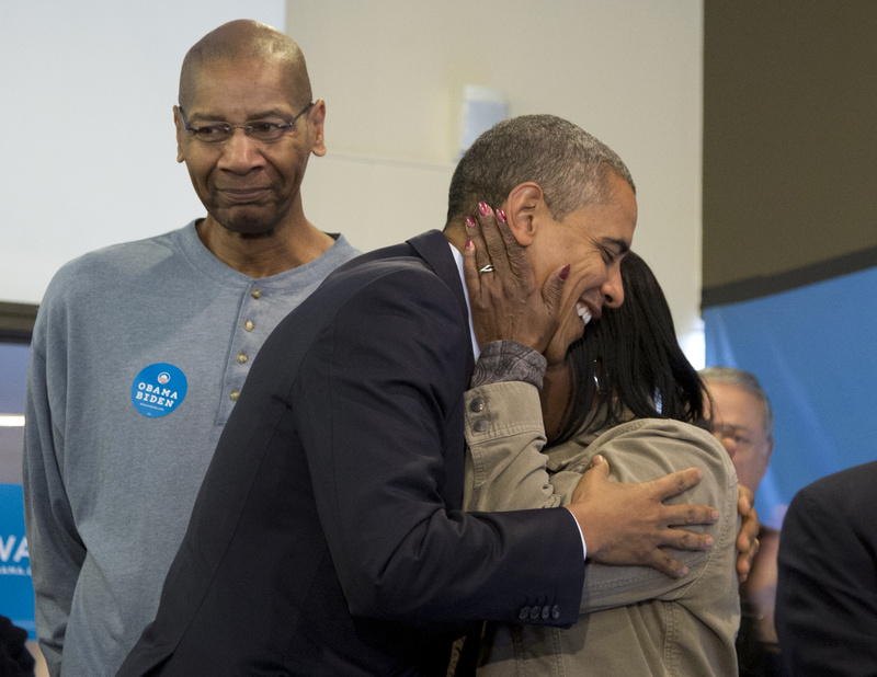 President Obama is embraced by a volunteer as he visits a campaign office in Chicago on Tuesday.