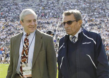 In this Oct. 8, 2011, photo then-Penn State President Graham Spanier, left, and head football coach Joe Paterno talk before a football game against Iowa in State College, Pa.