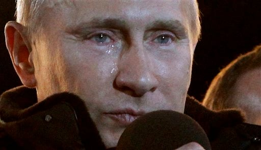 Russian Prime Minister Vladimir Putin, who claimed victory in Russia's presidential election, tears up as he reacts at a massive rally of his supporters outside the Kremlin in this March 4, 2012, photo.