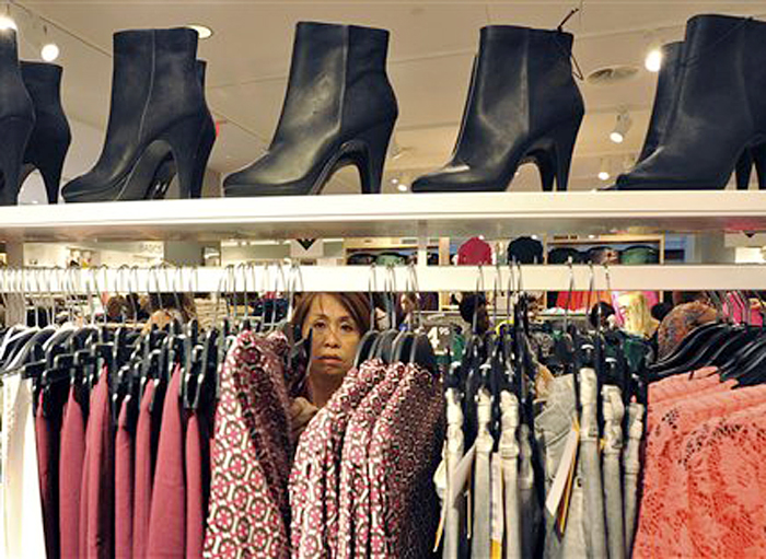 A woman shops recently at The Avenues Mall in Jacksonville, Fla. Economists say the gains in retail sales in August and September could bring stronger economic growth for the second half of the year.