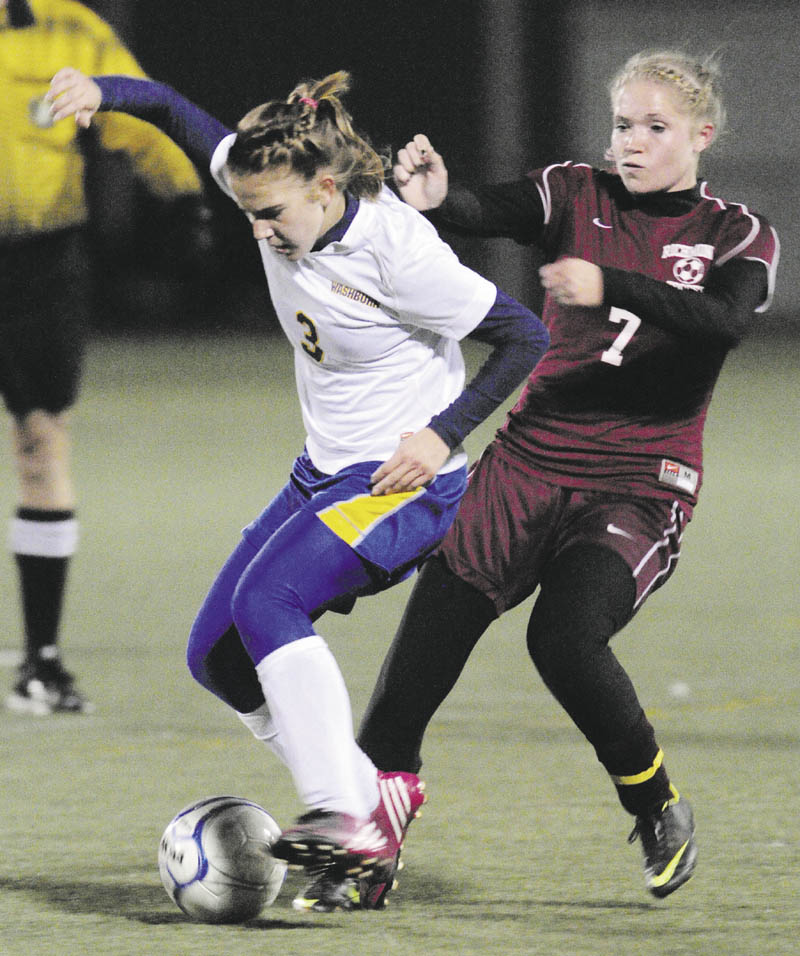GIVE ME THAT: Washburn's Carmen Bragg, left, and Richmond's Sadie Gosse battle for a ball during the Class D state championship game Saturday night at Hampden Academy.