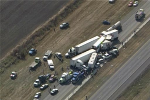 In this image provided by Click2houston.com cars and trucks are piled on Interstate 10 in southeast Texas on Thursday.