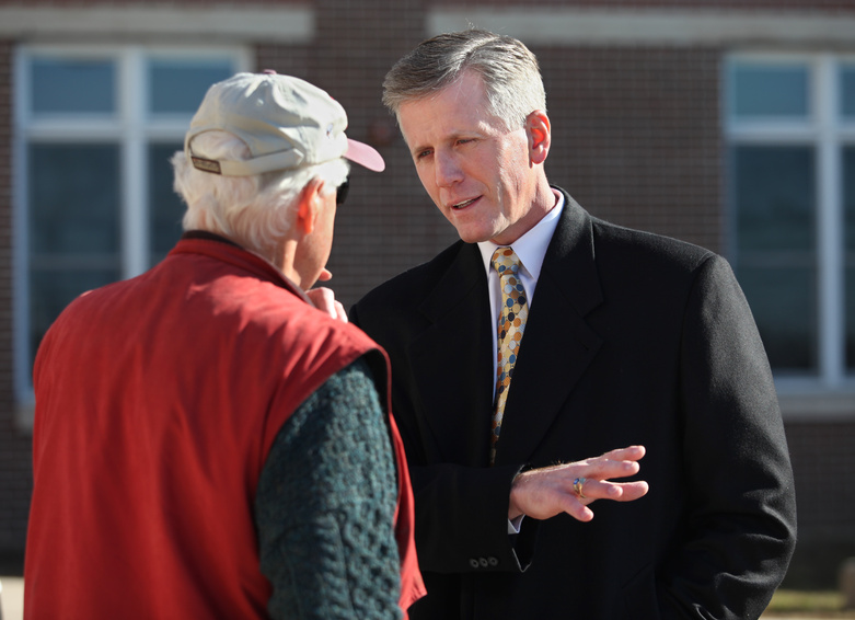 Republican U.S. Senate candidate Charlie Summers, right, speaks with Tom Skolfield Tuesday at the polling place at Scarborough High School.