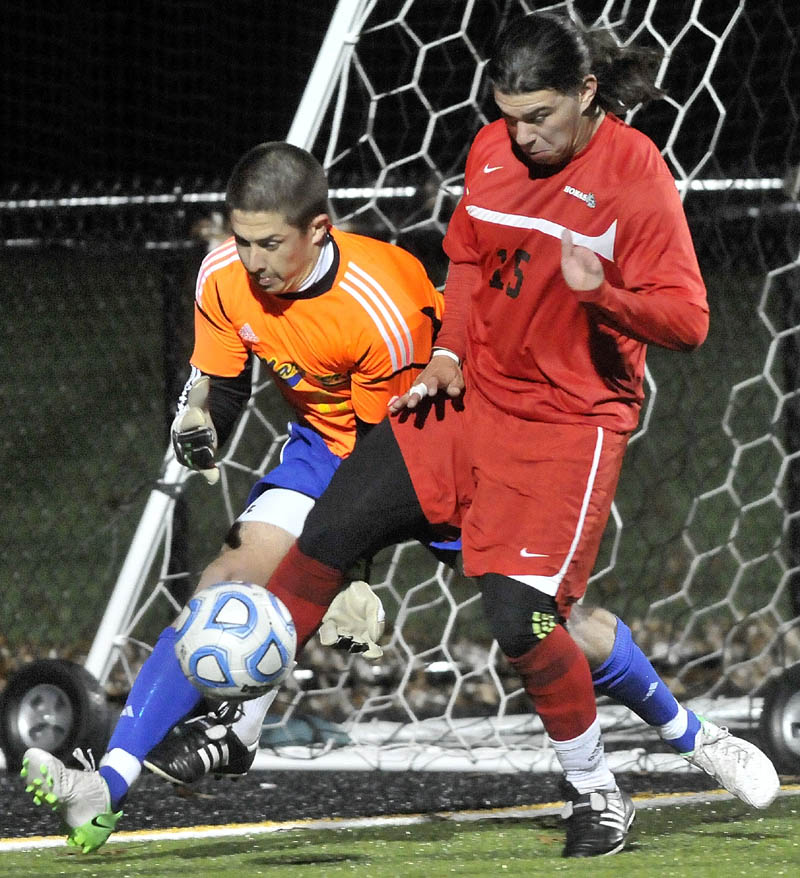 BATTLE IT OUT: Thomas's Kenny Cano, right, battles for the ball with Maine Maritime Academy goalie William Trace Lacour during the North Atlantic Conference semifinals Wednesday. The Terriers will face Williams College in the first-round of the NCAA Division III tournament Saturday.