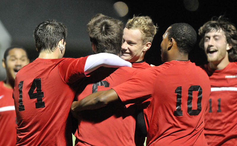 Thomas College teammates celebrate a goal against Maine Maritime Academy in the first half of a North Atlantic Conference semifinal game at Thomas College in Waterville on Wednesday.