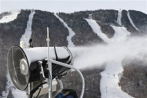 A snow gun makes fresh snow at the Stowe resort in Stowe, Vt., last Thursday. The ground might be bare, but ski areas across the Northeast are making big investments in high-efficiency snowmaking so they can open more terrain earlier and longer.