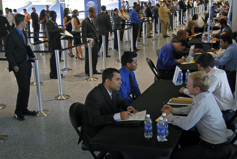 Job applicants are interviewed by Florida Marlins staff at Marlins Park in Miami.