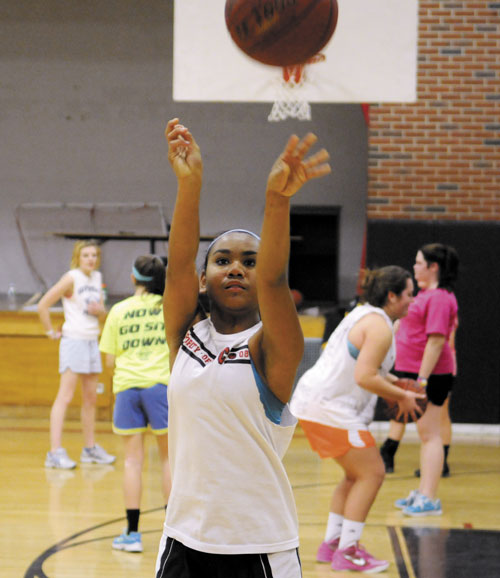 TIME TO START: Hall-Dale High School's Dani Sweet practices foul shots Monday on the first day of practice in Farmingdale.