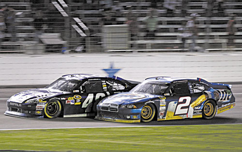 EDGING HIM OUT: Jimmie Johnson (48) and Brad Keselowski (2) bump on the front stretch late in a NASCAR Sprint Cup Series race Sunday at Texas Motor Speedway in Fort Worth, Texas. Johnson won the race.