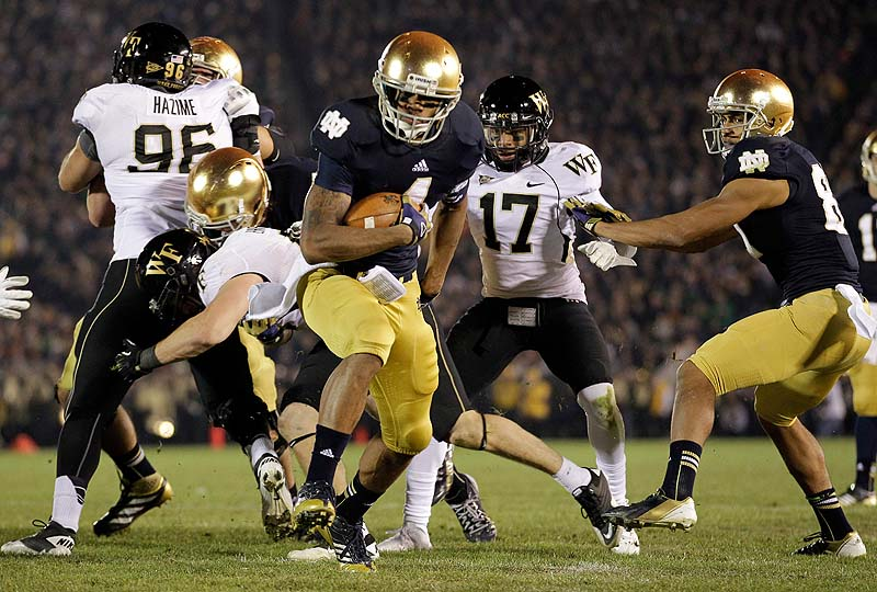 Notre Dame running back George Atkinson III scores a touchdown against Wake Forest Saturday in South Bend, Ind. Notre Dame defeated Wake Forest 38-0 and on Sunday was selected the top team in the AP Top 25 poll for the first time in 19 years.