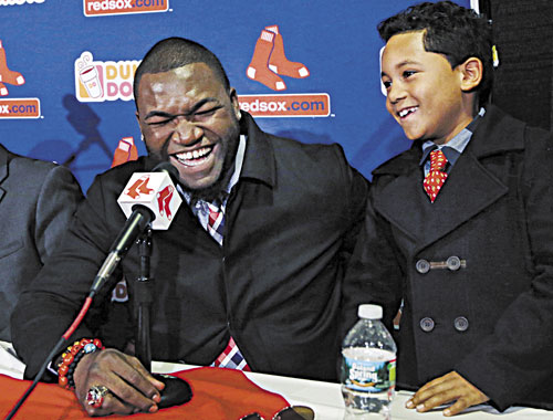 GLAD TO BE HERE: Boston's David Ortiz laughs with his son D'Angelo, 8, during a news conference Monday at Fenway Park in Boston. Ortiz announced that he has finalized a $26 million, two-year contract, which includes bonuses that could raise the value to $30 million.
