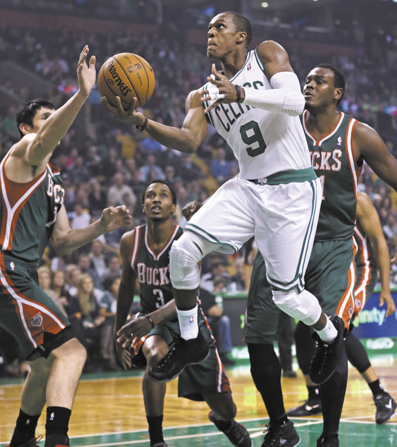 Boston Celtics guard Rajon Rondo drives to the basket against the Milwaukee Bucks in the first quarter of an NBA basketball game in Boston, Friday, Nov. 2, 2012. (AP Photo/Charles Krupa)