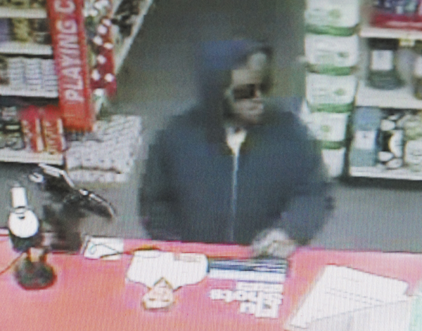 In this surveillance camera still image, the suspect in the Saturday robbery of the Capitol Street CVS pharmacy is shown.