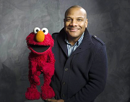 """Sesame Street"" puppeteer Kevin Clash poses with Elmo in this 2011 photo."