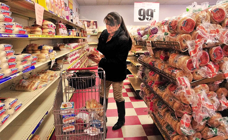 Doreen Campbell, of West Gardiner, shops for bread on Friday afternoon at the J.J. Nissen Hostess Bakery Outlet on Leighton Road in Augusta.