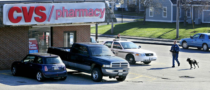Augusta and State Police officers investigate a robbery reported about 11 a.m. today at the CVS Pharmacy on Capitol Street in Augusta.