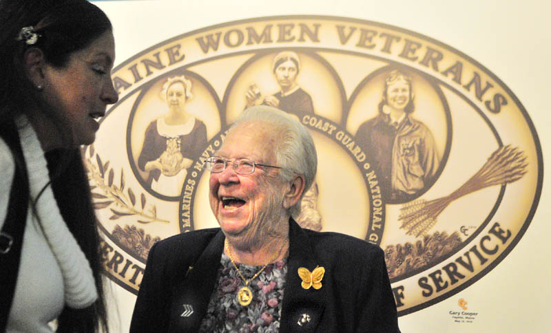 Shirley Chen, of Fairfield Center, who served as an Army private first class from 1979 to 1981, left, and Ruth Marshall Gilmore, of South China, who served as a sergeant in the Marine Corps from 1954-56, chat after the ceremony to present a commemorative silver coin to Maine women veterans on Friday afternoon in the Chapel at at the VA Healthcare Systems Maine Medical Center - Togus. Before the ceremony began, there had been a presentation to a World War II veteran who was a patient in the hospital there. The coin is a replica of the plaque displayed in the Hall of Flags depicting Maine women who served in different U.S. military capacities over four centuries. According to a press release, the featured women are: 18th century, Hannah Watts Weston, Revolutionary War patriot; 19th century, Emily W. Dana, Civil War Union Army nurse; 20th century, Patricia A. (Chadwick) Erickson, WWII Women Air Force Service Pilots; and 21st century, Sgt. Annette M. Bachman, war on terrorism, Maine Army National Guard.