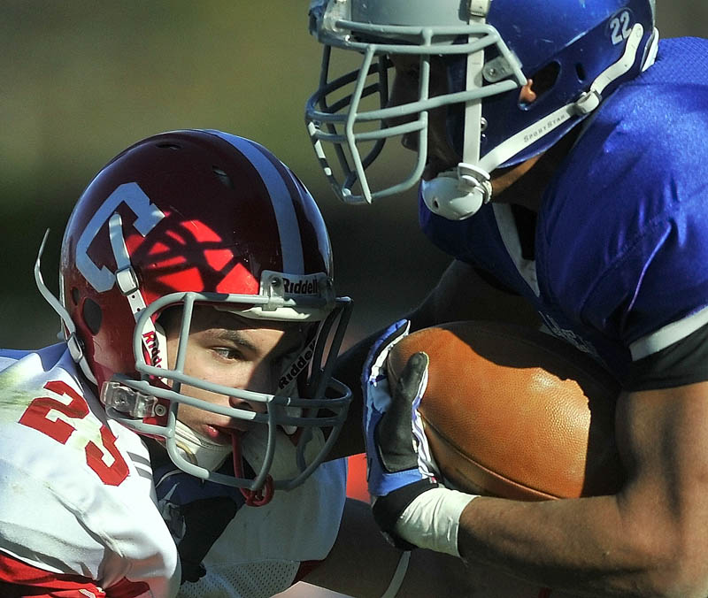 Cony High School's Tayler Carrier, left, gets an eyeful from Lawrence High School's Xavier Lewis Saturday.