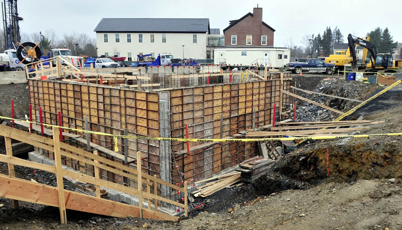 Workers construct the new science building on the Colby College campus on Thursday.