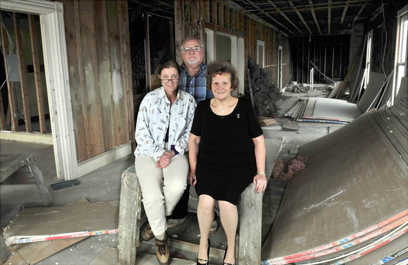 Carol Dyar-Eaton, left, and Erwin and Shirley Emery, inside their planned veterans shelter, in downtown Madison, on Wednesday.