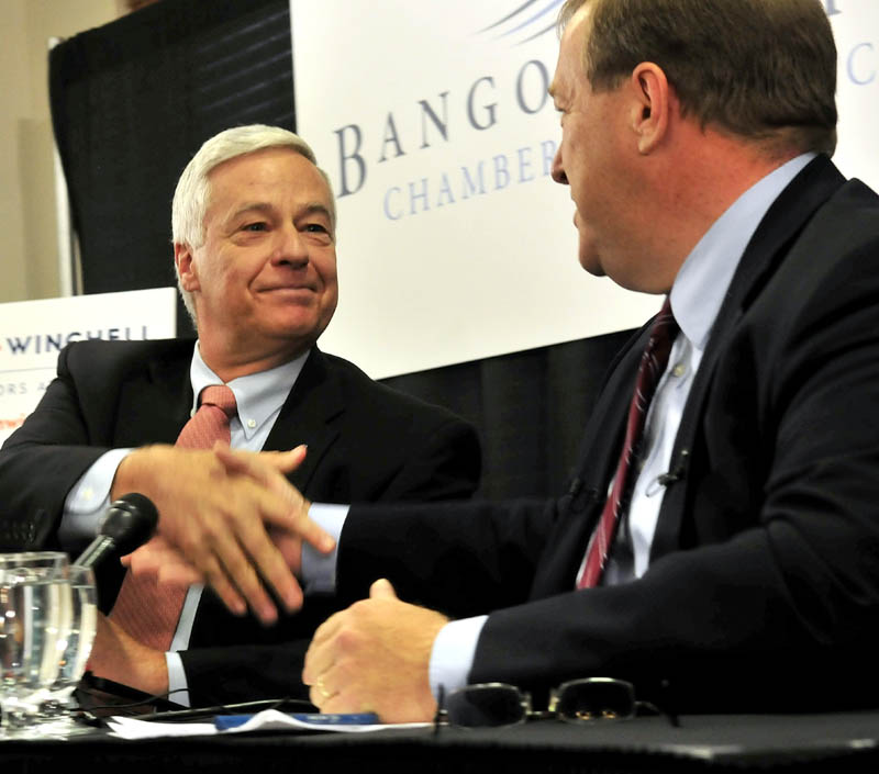U.S. Rep. Mike Michaud, left, and challenger Sen. Kevin Raye shake hands following a debate in Bangor on Oct. 16.