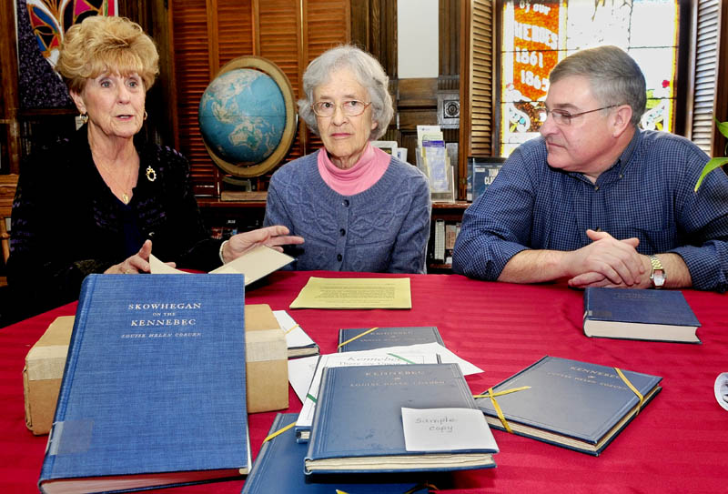 "Pat Dickey, left, Corrilla Hastings and Dale Jandreau talk about discovering 170 copies of ""Kennebec"", written by Louise Helen Coburn, at the Skowhegan Free Public Library, on Monday. The books will be on sale during the Christmas bazaar on Nov. 30 and Dec. 1, and proceeds will go to the library's renovation fund."