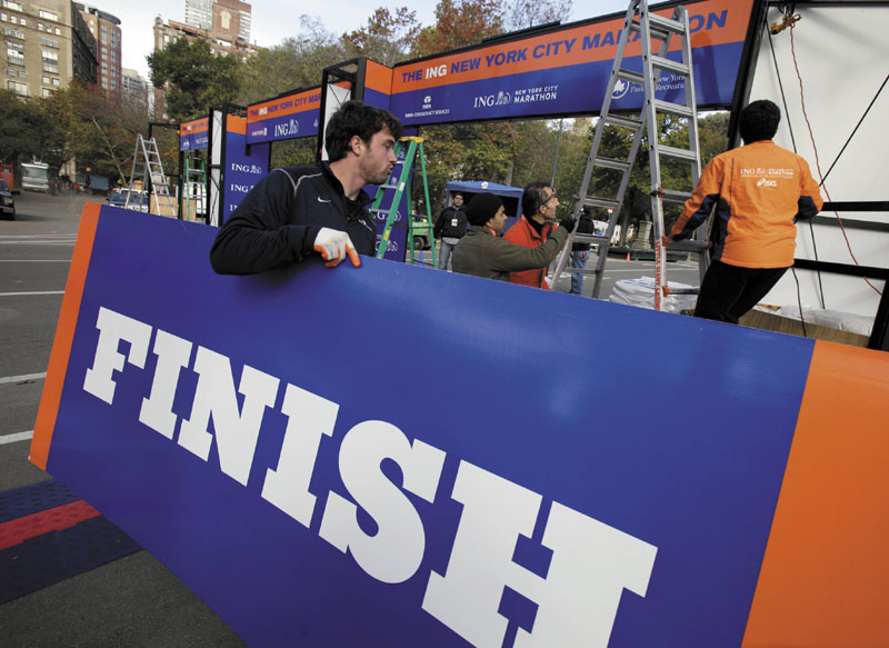 Workers assemble the finish line for the New York City Marathon in New York's Central Park, Thursday, Nov. 1, 2012. The 43rd New York City Marathon is on Sunday, with many logistical questions to be answered.