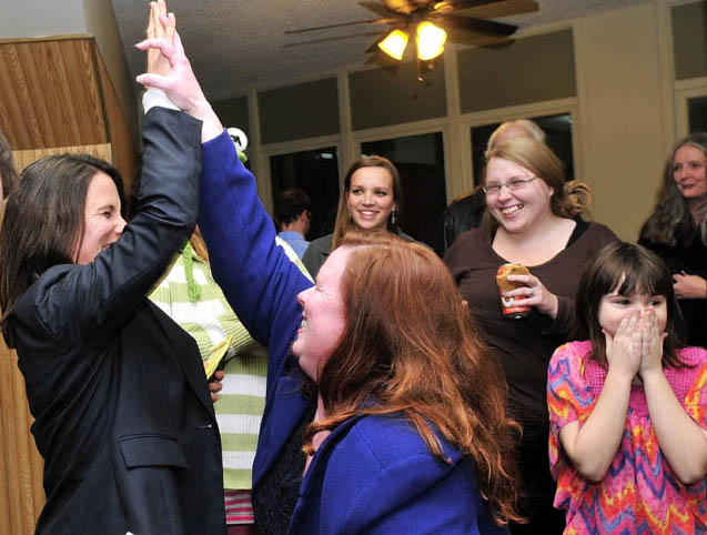 District Attorney candidate Maeghan Maloney, left, and Senate District 25 candidate Colleen Lachowicz react with joy following the closing of Waterville's polls on Tuesday.
