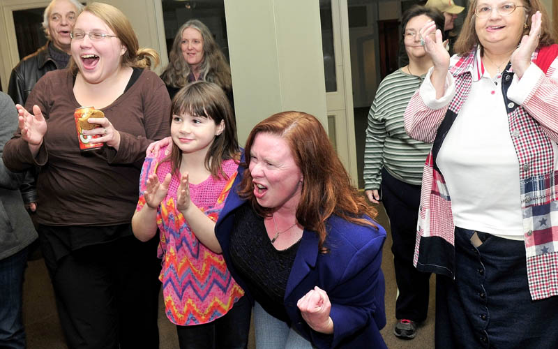 Colleen Lachowicz, Democratic candidate for Senate District 25, center, reacts after her husband Ed announced that she beat opponent Tom Martin in Waterville on Tuesday. At left are Rebecca Parker and Courtney Cote.