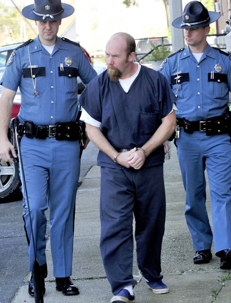 Robert Nelson is led out of Somerset County Superior Court in Skowhegan on Oct. 6, 2011, following a hearing in the shooting death of Everett Cameron.