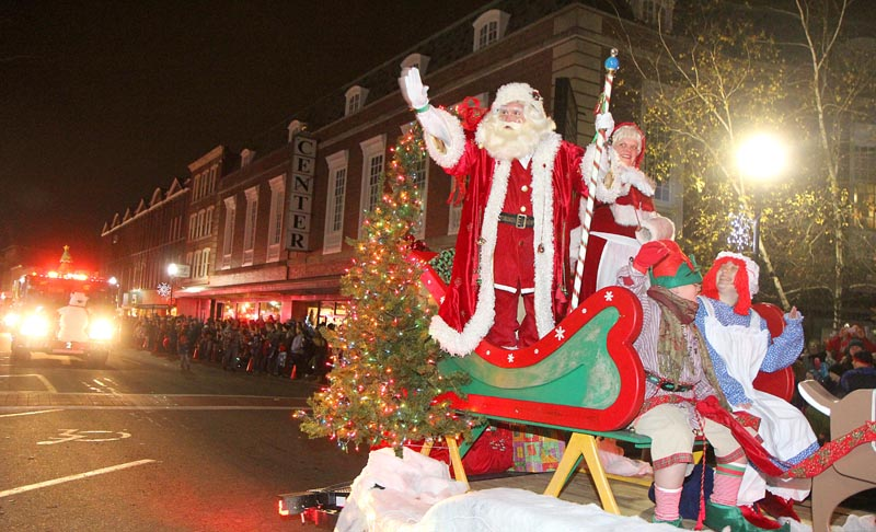 Santa and Mrs. Claus arrive in downtown Waterville during the 7th annual Parade of Lights on Friday night. The parade culminated with the lighting of the giant spruce tree in Castonguay Square and the opening of Kringleville.