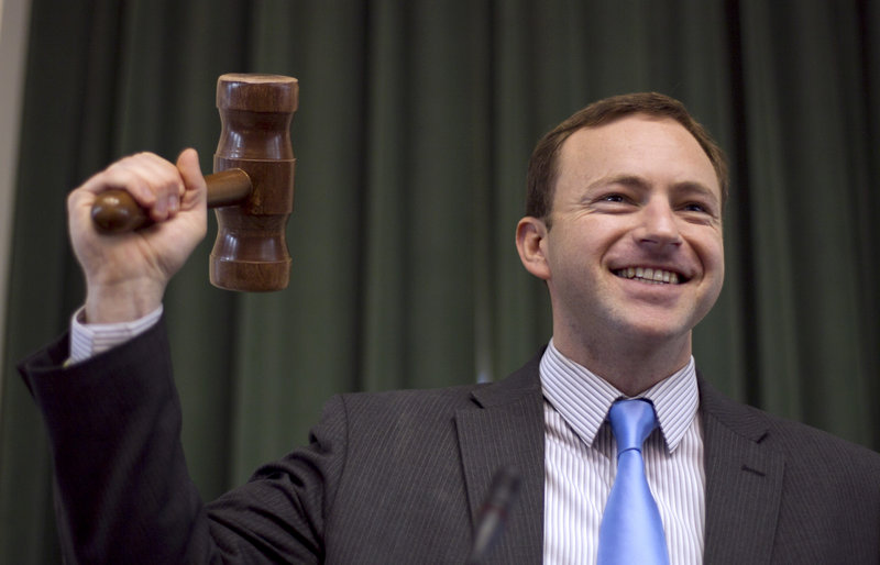 """Newly elected Speaker of the House Mark Eves, D-North Berwick, tries out the gavel Thursday at the State House. """"We have a great caucus with great potential,"""" he said."""
