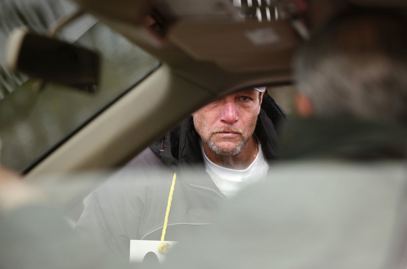 Joe Locey of Biddeford, a 13-year employee at the local Hostess plant, talks to a plant supervisor who was driving away from the site Friday. Hostess Brands Inc., which has opted to close its doors after 82 years following a decade of financial tumult, laid the blame on its bakery workers union, which went on strike Nov. 9.