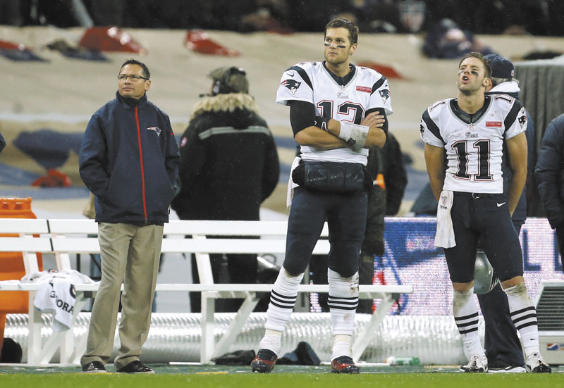 NO MORE WATCHING: New England Patriots wide receiver Julian Edelman, right, and quarterback Tom Brady, watch from the sidlines during the Patriots' game against the St. Louis Rams on Sunday, Oct. 29 in London. After a bye week, the Patriots return to action Sunday against Buffalo.